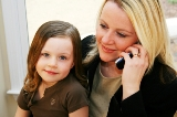 Mother on Cell Phone with her Child